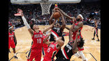 Portland Trail Blazers center Hassan Whiteside (21) pulls down a rebound over forward Nassir Little (9) and New Orleans Pelicans center Jaxson Hayes (10), guard Frank Jackson (15) and forward Brandon Ingram, right, in the first half of an NBA basketball game in New Orleans, Tuesday, Nov. 19, 2019. (AP Photo/Gerald Herbert)