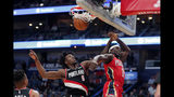 New Orleans Pelicans guard Jrue Holiday (11) slam dunks as he is fouled by Portland Trail Blazers forward Nassir Little (9) in the first half of an NBA basketball game in New Orleans, Tuesday, Nov. 19, 2019. (AP Photo/Gerald Herbert)