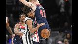 San Antonio Spurs guard Patty Mills, left, tries to get past Washington Wizards forward Davis Bertans (42) during the first half of an NBA basketball game, Wednesday, Nov. 20, 2019, in Washington. (AP Photo/Nick Wass)