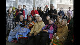 Sacheen Littlefeather, second from right in the front row, listens to ceremonies marking the 50th anniversary of the Native American occupation of Alcatraz Island Wednesday, Nov. 20, 2019, in San Francisco. About 150 people gathered at Alcatraz to mark the 50th anniversary of a takeover of the island by Native American activists. Original occupiers, friends, family and others assembled Wednesday morning for a program that included prayer, songs and speakers. They then headed to the dock to begin restoring messages painted by occupiers on a former barracks building. In 1973 Littlefeather represented Marlon Brando at the Oscars to decline his Best Actor award. (AP Photo/Eric Risberg)