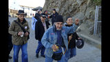 Eloy Martinez, who took part in the Native American occupation, raises a fist while making his way to ceremonies marking the 50th anniversary of the occupation on Alcatraz Island, Wednesday, Nov. 20, 2019, in San Francisco. About 150 people gathered at Alcatraz to mark the 50th anniversary of a takeover of the island by Native American activists. Original occupiers, friends, family and others assembled Wednesday morning for a program that included prayer, songs and speakers. (AP Photo/Eric Risberg)