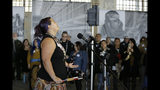 Kanyon Sayers-Woods sings during ceremonies marking the 50th anniversary of the Native American occupation on Alcatraz Island Wednesday, Nov. 20, 2019, in San Francisco. About 150 people gathered at Alcatraz to mark the 50th anniversary of a takeover of the island by Native American activists. Original occupiers, friends, family and others assembled Wednesday morning for a program that included prayer, songs and speakers. They then headed to the dock to begin restoring messages painted by occupiers on a former barracks building. (AP Photo/Eric Risberg)