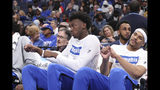 Memphis' James Wiseman, second from right, sits out the game along with Isaiah Stokes, right, in an NCAA college basketball game against Alcorn State Saturday, Nov. 16, 2019, in Memphis, Tenn. Malcolm Dandridge is first from right. (AP Photo/Karen Pulfer Focht)