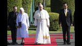 Pope Francis, center, walks with his cousin Ana Rosa Sivori, left, and Thailand's Prime Minister Prayuth Chan-ocha, right, during a welcoming ceremony at the government house in Bangkok, Thailand, Thursday, Nov. 21, 2019. Pope Francis is on a four-day visit to Thailand. (AP Photo/Sakchai Lalit)