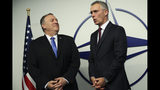 U.S. Secretary of State Mike Pompeo, left, is welcomed by NATO Secretary General Jens Stoltenberg after arriving for a NATO Foreign Ministers meeting at the NATO headquarters in Brussels, Wednesday, Nov. 20, 2019. (AP Photo/Francisco Seco, Pool)