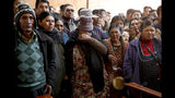 Relatives and friends mourn next to the bodies of people killed during clashes between security forces and supporters of former President Evo Morales, at the San Francisco de Asis church in El Alto, outskirts of La Paz, Bolivia, Wednesday, Nov. 20, 2019. Police and soldiers on Tuesday escorted gasoline tankers from a major fuel plant that had been blockaded for five days by Morales' backers and at least three people were reported killed while the operation was underway. (AP Photo/Natacha Pisarenko)