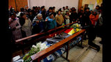 Relatives mourn during the funeral of people killed during clashes between security forces and supporters of former President Evo Morales, at the San Francisco de Asis church in El Alto, outskirts of La Paz, Bolivia, Wednesday, Nov. 20, 2019. Police and soldiers on Tuesday escorted gasoline tankers from a major fuel plant that had been blockaded for five days by Morales' backers and at least three people were reported killed while the operation was underway. (AP Photo/Natacha Pisarenko)