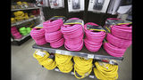 Extension cords of all gauges and lengths stock the shelves at B&C Ace hardware, Tuesday, Nov. 19, 2019, in Grass Valley, Calif., in anticipation of the next public safety power shutdowns. (Elias Funez/The Union via AP)