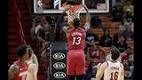 Miami Heat center Bam Adebayo (13) dunks over Cleveland Cavaliers forward Cedi Osman (16) during the first half of an NBA basketball game, Wednesday, Nov. 20, 2019, in Miami. (AP Photo/Lynne Sladky)