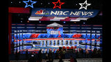 In this Tuesday, Nov. 19, 2019 photo, people gather around the stage for the Democratic presidential primary before Wednesday's debate in Atlanta. (AP Photo/Mike Stewart)