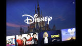 FILE - In this Wednesday, Nov. 13, 2019 file photo, a Disney logo forms part of a menu for the Disney Plus movie and entertainment streaming service on a computer screen in Walpole, Mass. Disney Plus says it doesn't have a security breach, but some users of the new streaming service have been shut out after hackers tried to break into their accounts. (AP Photo/Steven Senne, File)