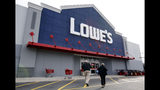 FILE - In this Nov. 14, 2011 file photo, customers walk toward the Lowe's store in Saugus, Mass. Lowe's Cos. (LOW) on Wednesday, Nov. 20, 2019, reported fiscal third-quarter net income of $1.05 billion. (AP Photo/Michael Dwyer/File)