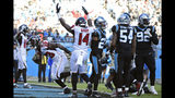 Atlanta Falcons running back Brian Hill (23) scores a touchdown against the Carolina Panthers while wide receiver Justin Hardy (14) reacts during the second half of an NFL football game in Charlotte, N.C., Sunday, Nov. 17, 2019. (AP Photo/Mike McCarn)