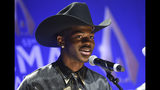FILE - This Nov. 13, 2019 file photo shows rapper Lil Nas X after winning the musical event of the year award at the 53rd annual CMA Awards in Nashville, Tenn. Genre-mashing, bold and chart-topping new artists have caught the attention of the Recording Academy, as Lizzo, Billie Eilish and Lil Nas X lead in nominations at the 2020 Grammy Awards. (Photo by Evan Agostini/Invision/AP, File)