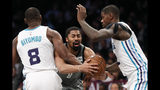 Charlotte Hornets center Bismack Biyombo (8) and forward Marvin Williams, right, defend against Brooklyn Nets guard Spencer Dinwiddie, center, during the second half of an NBA basketball game Wednesday, Nov. 20, 2019, in New York. (AP Photo/Kathy Willens)