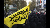 """A banner in Persian that reads, """"Death to Israel,"""" is carried as mourners attend a funeral procession of Revolutionary Guard member Morteza Ebrahimi, who was killed during recent protests, in Shahriar, Iran, some 40 kilometers (25 miles) southwest of the capital, Tehran, Wednesday, Nov. 20, 2019. Ebrahimi was killed during protests over government-set fuel prices rising last week, demonstrations that quickly spiraled in violence. (AP Photo/Vahid Salemi)"""