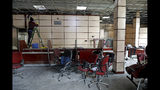 A worker cleans the walls of a bank that was attacked during protests over rises in government-set gasoline prices, in Tehran, Iran, Wednesday, Nov. 20, 2019. Demonstrations struck at least 100 cities and towns, spiraling into violence that saw banks, stores and police stations attacked and burned. (AP Photo/Ebrahim Noroozi)