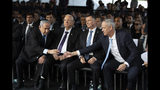 Blue and White Party leader Benny Gantz, right, reaches out to shake hands with Israeli Prime Minister Benjamin Netanyahu at an official memorial for former Israeli Prime Minister Yitzhak Rabin and his wife Leah, commemorating 24 years since the assassination of Rabin, at Mt. Herzl in Jerusalem, Sunday, Nov. 10, 2019. (Heidi Levine/Pool via AP)
