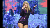 """FILE - In this July 10, 2019 file photo, singer Taylor Swift performs at Amazon Music's Prime Day concert in New York. Swift's newest album, """"Lover,"""" was released a week before the Grammys' due date, and could snag a nomination. (Photo by Evan Agostini/Invision/AP, File)"""