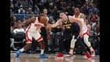 Houston Rockets guard James Harden, left, pursues a loose ball with Denver Nuggets center Nikola Jokic in the first half of an NBA basketball game Wednesday, Nov. 20, 2019, in Denver. (AP Photo/David Zalubowski)