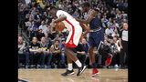 Houston Rockets center Clint Capela, left, gathers in a loose ball as Denver Nuggets forward Jerami Grant defends in the first half of an NBA basketball game Wednesday, Nov. 20, 2019, in Denver. (AP Photo/David Zalubowski)