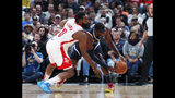 Houston Rockets guard James Harden, left, fouls Denver Nuggets forward Paul Millsap in the first half of an NBA basketball game Wednesday, Nov. 20, 2019, in Denver. (AP Photo/David Zalubowski)
