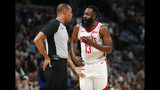 Houston Rockets guard James Harden, right, argues with referee Rodney Mott for a foul after he drove the lane against the Denver Nuggets in the first half of an NBA basketball game Wednesday, Nov. 20, 2019, in Denver. (AP Photo/David Zalubowski)