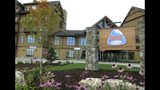 FILE - In this Sept. 1, 2016, file photo, the Lodge at Burke Mountain is pictured on the day it officially opened in East Burke, Vt. Foreigners who invested in the Jay Peak and Burke Mountain ski area developments that are now linked to alleged fraud say the federal government is declining to act on their petitions for U.S. residency. A federal lawsuit filed in Florida on Friday, Nov. 13, 2019, accuses the U.S. Citizenship and Immigration Services of leaving their residency petitions in limbo. The agency declined comment. (AP Photo/Lisa Rathke, File)