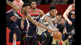 San Antonio Spurs guard Dejounte Murray, right, and Washington Wizards guard Jordan McRae (52) reach for the ball during the first half of an NBA basketball game Wednesday, Nov. 20, 2019, in Washington. (AP Photo/Nick Wass)