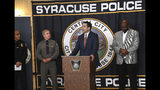 Peter Fitzgerald from the FBI addresses questions about a series of racist messages and hate crimes that have occurred at SU in the last two weeks during a press conference Tuesday, Nov. 19, 2019, at the Public Safety Building in Syracuse, N.Y. On the far left is Syracuse University DPS Chief Bobby Maldonado. Next to him is Major Philip Rougeux, Troop D Commander for the New York State Police. At right is Syracuse Police Chief Kenton Buckner. (Lauren Long/The Syracuse Newspapers via AP)