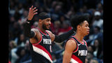 Portland Trail Blazers forward Carmelo Anthony, left, reacts as he walks to the bench with guard Anfernee Simons during the second half of the team's NBA basketball game against the New Orleans Pelicans in New Orleans, Tuesday, Nov. 19, 2019. The Pelicans won 115-104. (AP Photo/Gerald Herbert)
