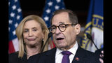 FILE - In this Oct. 31, 2019 file folder, Rep. Jerrold Nadler, D-N.Y., chairman of the House Judiciary Committee, joined at left by Rep. Carolyn Maloney, acting chair of the House Committee on Oversight and Reform, meets with reporters at the Capitol in Washington. A divided House panel has endorsed a proposal to decriminalize and tax marijuana at the federal level. Groups supporting an end to the national prohibition on pot call the 24-10 vote by the House Judiciary Committee historic. However, even if passed in the House, the proposal faces an uncertain future in the Republican-controlled Senate. (AP Photo/J. Scott Applewhite, FIle)
