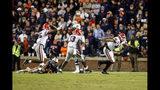 Georgia defensive lineman Travon Walker (44) celebrates after sacking Auburn quarterback Bo Nix (10) to secure the 21-14 win in the second half of an NCAA college football game, Saturday, Nov. 16, 2019, in Auburn, Ala. (AP Photo/Butch Dill)