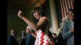 """FILE - In this Dec. 6, 2016 file photo, Baltimore Mayor Catherine Pugh gives a thumbs-up to supporters after her inauguration ceremony inside the War Memorial Building in Baltimore. The disgraced former mayor of Baltimore was charged Wednesday, Nov. 20, 2019, with fraud and tax evasion involving sales of her self-published children's books. An 11-count federal indictment accuses Pugh of using her """"Healthy Holly"""" children's books to enrich herself, promote her political career and fund her run for mayor. (AP Photo/Patrick Semansky, File)"""