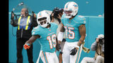 Miami Dolphins wide receiver Albert Wilson (15), congratulates wide receiver Jakeem Grant (19), after Grant scored a touchdown during the second half at an NFL football game against the Buffalo Bills, Sunday, Nov. 17, 2019, in Miami Gardens, Fla. (AP Photo/Wilfredo Lee)