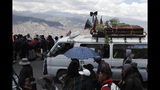 Anti-government demonstrators accompany a coffin that contains the remains of a person killed in clashes between supporters of former President Evo Morales and security forces, in a funeral procession into La Paz, Bolivia, Thursday, Nov. 21, 2019. At least eight people were killed Tuesday when security forces cleared a blockade of a fuel plant by supporters of former President Evo Morales at protesters in the city of El Alto. (AP Photo/Natacha Pisarenko)