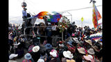 Anti-government demonstrators accompany the remains of people killed in clashes between supporters of former President Evo Morales and security forces, in a funeral procession into La Paz, Bolivia, Thursday, Nov. 21, 2019. At least eight people were killed Tuesday when security forces cleared a blockade of a fuel plant by supporters of former President Evo Morales at protesters in the city of El Alto. (AP Photo/Natacha Pisarenko)