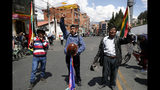 Anti-government demonstrators chant during a funeral procession for people killed in clashes between supporters of former President Evo Morales and security forces, in La Paz, Bolivia, Thursday, Nov. 21, 2019. At least eight people were killed Tuesday when security forces cleared a blockade of a fuel plant by Morales's backers in the city of El Alto. (AP Photo/Natacha Pisarenko)