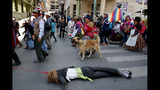 Anti-government demonstrators drag a dummy representing Bolivia's interim President Jeanine Anez in La Paz, Bolivia, Thursday, Nov. 21, 2019. Anez sent a bill on holding new elections to congress Wednesday amid escalating violence that has claimed at least 30 lives since a disputed Oct. 20 vote and the subsequent resignation and exile of former President Evo Morales. (AP Photo/Natacha Pisarenko)