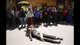 An anti-government demonstrator drags a dummy representing Bolivia's interim President Jeanine Anez in La Paz, Bolivia, Thursday, Nov. 21, 2019. Anez sent a bill on holding new elections to congress Wednesday amid escalating violence that has claimed at least 30 lives since a disputed Oct. 20 vote and the subsequent resignation and self-imposed exile of former President Evo Morales. (AP Photo/Natacha Pisarenko)