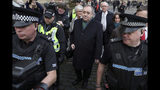 Former Scottish leader Alex Salmond, center, leaves the High Court in Edinburgh, Thursday Nov. 21, 2019. Salmond, one of the country's best-known politicians, appeared in court faces a total of 14 charges of attempted rape, sexual assault and indecent assault against 10 women. (Andrew Milligan/PA via AP)