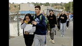 "FILE - This Nov. 14, 2019 file photo shows students being escorted out of Saugus High School after a shooting on the campus in Santa Clarita, Calif. Authorities say the teenager who shot five classmates, killing two, at a Southern California high school used an unregistered ""ghost gun."" Los Angeles County Sheriff Alex Villanueva Villanueva told media outlets Thursday, Nov. 21, 2019 that Nathaniel Tennosuke Berhow's semi-automatic handgun had been assembled and did not have a serial number. Authorities are still working to determine how Berhow got the handgun. Berhow died from a self-inflicted gunshot wound after the shooting. (AP Photo/Marcio Jose Sanchez, File)"