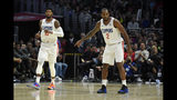 Los Angeles Clippers forward Paul George, left, and forward Kawhi Leonard stand on the court during the second half of the team's NBA basketball game against the Boston Celtics on Wednesday, Nov. 20, 2019, in Los Angeles. (AP Photo/Mark J. Terrill)