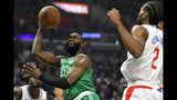 Boston Celtics guard Jaylen Brown shoots as Los Angeles Clippers forward Kawhi Leonard defends during the first half of an NBA basketball game Wednesday, Nov. 20, 2019, in Los Angeles. (AP Photo/Mark J. Terrill)