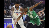 Los Angeles Clippers forward Paul George, left, and Boston Celtics guard Kemba Walker go after a loose ball during the first half of an NBA basketball game Wednesday, Nov. 20, 2019, in Los Angeles. (AP Photo/Mark J. Terrill)