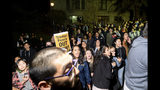 """Protesters yell at audience members leaving a speech by conservative commentator Ann Coulter on Wednesday, Nov. 20, 2019, in Berkeley, Calif. Hundreds of demonstrators gathered on campus as Coulter delivered a talk titled """"Adios, America!"""" (AP Photo/Noah Berger)"""