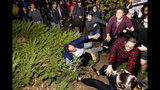"""A man leaving a speech by conservative commentator Ann Coulter falls to the ground after being pushed by protesters at the University of California, Berkeley, Wednesday, Nov. 20, 2019, in Berkeley, Calif. Hundreds of demonstrators gathered as Coulter delivered a talk titled """"Adios, America!"""" (AP Photo/Noah Berger)"""