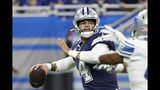 Dallas Cowboys quarterback Dak Prescott (4) is pressured during the first half of an NFL football game against the Detroit Lions, Sunday, Nov. 17, 2019, in Detroit. (AP Photo/Rick Osentoski)