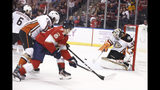 Anaheim Ducks goaltender John Gibson (36) protects the goal agains the Florida Panthers during the second period of an NHL hockey game, Thursday, Nov. 21, 2019, in Sunrise, Fla. (AP Photo/Brynn Anderson)