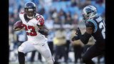 Carolina Panthers cornerback James Bradberry (24) chases Atlanta Falcons running back Brian Hill (23) during the second half of an NFL football game in Charlotte, N.C., Sunday, Nov. 17, 2019. (AP Photo/Brian Blanco)